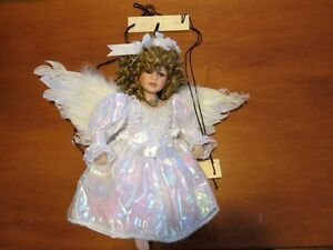 Angel on Swing Porcelain Doll : Cathay Collection London Ontario image 1
