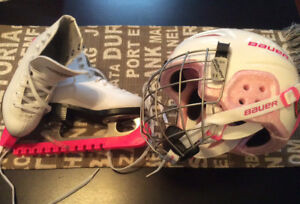 Child's size 11 ice skates and pink helmet