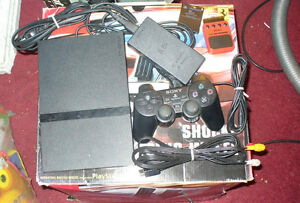 PlayStation two slim with box lot of games controllers and more