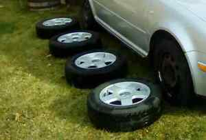 195/65/15 Volkswagen  Jetta Golf all season tires and rims.