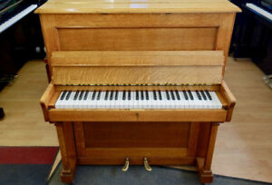 Upright piano with 5 octaves
