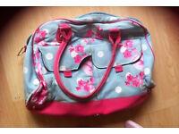 Baby changing bag next bag