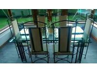 Glass top wrought iron table and 6 chairs