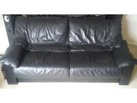 Black, high quality, genuine leather 3 seater sofa and chair. Cash on collection.