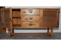 Pine sideboard, with three drawers and two cupboards, brass fittings
