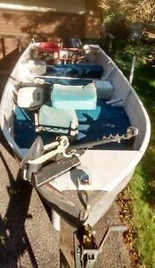 Al boat with trailer, 15 HP motor, and accessories