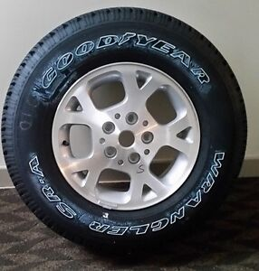 Mint condition Goodyear Wrangler tire on rim for sale.