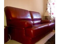 Almost brand new 2 red leather sofas for sale.
