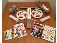 Nintendo Wii, 2 controllers, 2 steering wheels, nunchuck and 4 games!