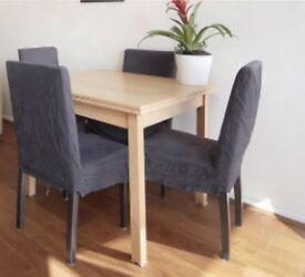 Wooden dining table - extendable