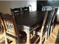 Solid large dark wood table and 6 chairs