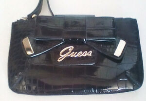 GUESS: Laurita Black Patent Bow Wristlet/Clutch