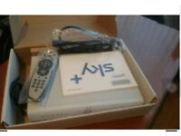 SKY + BOX NEARLY LIKE NEW WITH SCRAT CABLE ,POWER CABLE,REMOTE CONTROL FOR SALE