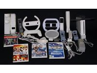 NINTENDO WII WITH ACCESORIES AND GAMES