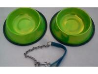 Two dog bowls, green with non slip black rubber base, and one short dog lead