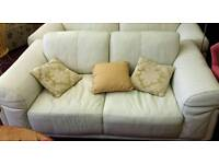 THREE AND TWO SEATER LEATHER SOFAS IN IVORY
