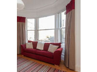 Pair of heavyweight curtains for large bay window