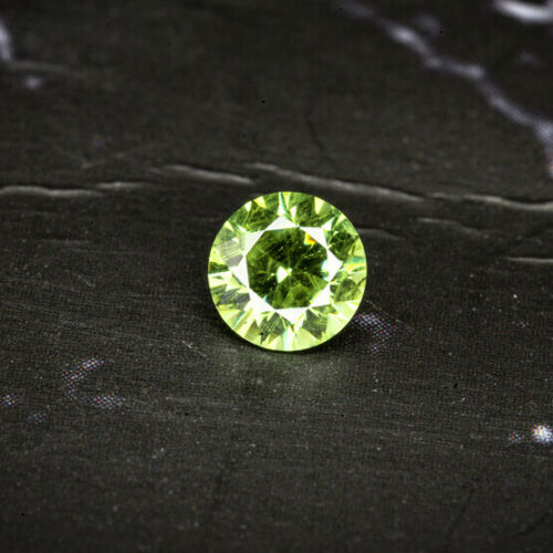 DEMANTOID, RUSSIA 0.31Ct EYE CLEAN WITH HORSETAIL INCLUSION, ROUND CUT 4.0 mm