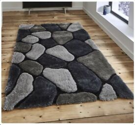 New grey and black pebble rug 7.6ft x 5.3ft still in rapper