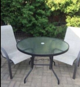 Round patio table and two chairs