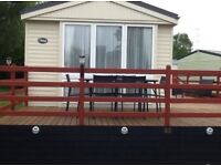 12FT WIDE 2 BED CENTRALLY HEATED CARAVAN WITH FRONT & SIDE VERANDAH ON RIVERSIDE PARK IN WOOLER