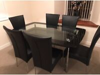 Dining table with 4 chairs. Chairs good condition , glass some light scratch's. great item for price