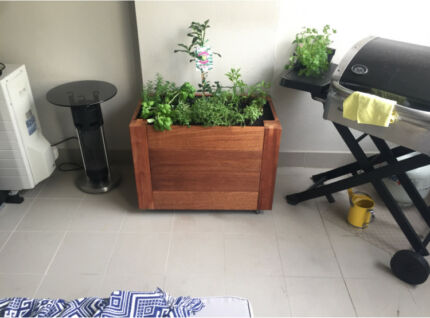 Solid timber garden plants bed pot fully irrigated on wheels