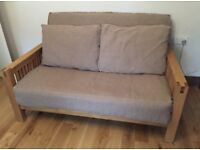 Solid oak frame 2 seater futon/sofa bed by Futon company with trifold mattress and cushions