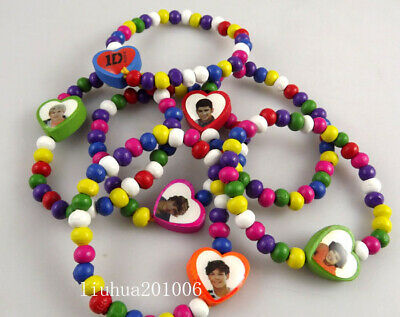 For sale 12 One Direction Wood beads Stretch Bracelets Lovely child wristband