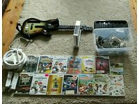 Wii - console, 14 games, guitar, 3 steering wheels, 3 controllers