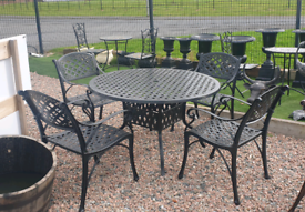 Black cast aluminium round table and 4 armchairs Garden furniture