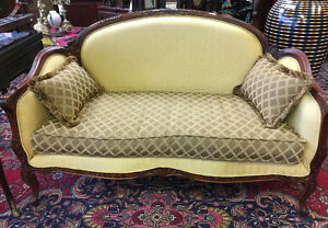 set including a loveseat, and the matching stool and pillows
