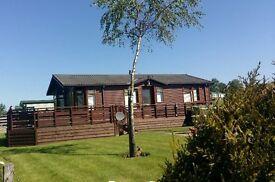A Lodge in Cumbria: Omar Kingfisher 36 x 20 foot 2 bedroom pine lodge with hot tub: sleeps 8.