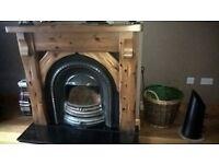 Beautiful fireplace surround an cast metal inset