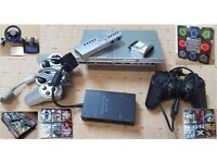 Slim PS2 Console with more than 50 games, Racing Wheel, Dance Board, Multi Tap, Remote etc.