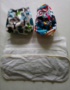 2 very cute cloth diaper sets