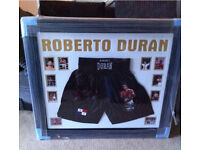 Late great Roberto Duran signed shorts, Frames with pictures.