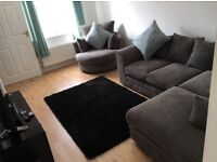 Grey right hand corner sofa and swivel chair