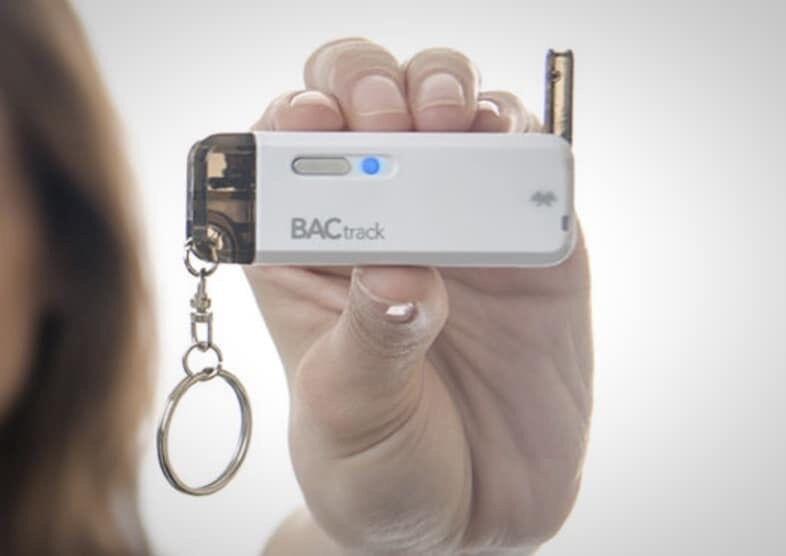 Breathalyzer. Alcohol Tester. BACtrack Vio Smartphone.MICROC