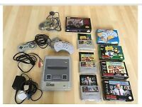 Super Nintendo Entertainment System Console with 3 controllers and 3 games.