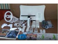 Nintendo WII white console with WII Fit board, 2 controllers , 2 Nun chuks, 6 Games & Accessories