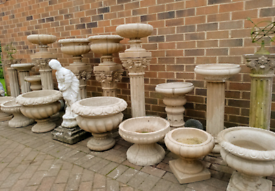 Large selection of stone garden urn planters, columns etc