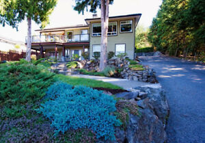 Custom home with mountain and ocean views in NANOOSE