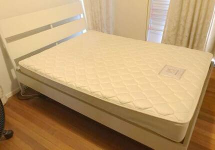 Excellent wooden double bed frame with mattress. Delivery availab