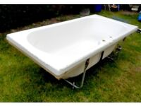 Large White Bath and Taps