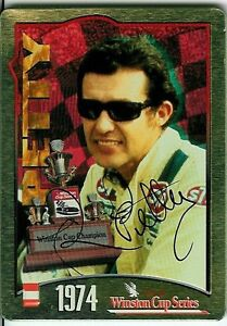 4 Autographed Richard Petty Tin Trading Cards