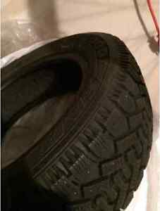 Goodyear Winter Tires P185/60R15 (no rims). Uses for 4 winters