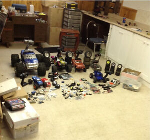 RC trucks+boxes of parts