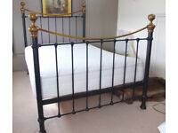 Brass bed.