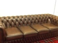 Brown leather Chesterfield sofas
